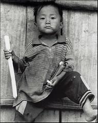 (richard thomson) Tags: boy blackandwhite bw village 85mm pride 35mmfilm laos fp4 nikonfe2 85mmlens