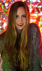Merry Christmas! (panoqui) Tags: greeting navidad 50mm selfportrait eyes christmaslights lights christmasbokeh christmas bokeh verde rojo red green longhair hair face woman girl retrato portrait