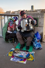 On a cold winter day a street muscian playing an accordion for spare change on Pont Saint Louis in Paris, France. (thstrand) Tags: accordionplayer accordionist adultmale arts bridge bridges brightcolors business businessandindustry busker busking city cold colorful culture employment entertainer entertaining entertainment europe france french geographycountries january job jobs keyboard man men music musicalinstrument musician musicians oneperson paris performance performingartist performingarts playinganaccordion playingformoney pontsaintlouis scenicviews seasons solo squeezebox streetmuscian streetscene tourism touristattraction traveldestination traveldestinations urbanscene warmclothing winter work working workingforaliving
