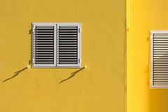 One and a half windows (Jan van der Wolf) Tags: map167317vvv crucedearinaga shutters shadowplay schaduwen windows ramen yellow gevel geel facade geometric gebouw geometry geometrisch geometrie architecture architectuur grancanaria