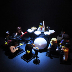 LEGO balances 100% of energy use with renewable resources. (jefalump) Tags: lego minifig minifigure concert drums saxophone microphone guitars musicians singers 100percent 100 lowlight blackbackground flickrfriday