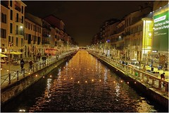 The River is Everywhere (Steve Lundqvist) Tags: fujifilm x100s x100 milan italy streetphotography street people athlete pov naviglio grande navigli canal river lights night low reflection milano italia travel trip notte luci