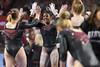 DU Gymnastics - Lynnzee Brown (brittanyevansphoto) Tags: collegegymnastics ncaagymnastics denvergymnastics unevenbars celebration highfive