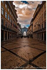 Lisbon, Portugal. Pedestrian walk, facing south, toward the Tagus River. (Fotofricassee) Tags: river tagus lisbon monument sculpture cobblestone stores flats pastels daybre sun