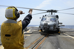 180410-N-HE318-0075 (U.S. Pacific Fleet) Tags: ussmustin ddg89 warlords helicoptermaritimestrikesquadron hsm51 mh60r seahawk boatswain'smate pettyofficer flightquarters usnavy navy philippinesea boatswain'smate