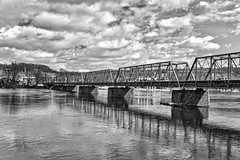 The Dividing Line BW (brev99) Tags: d610 tamron28300xrdiif newhope newjersey ononesoftware on1photoraw2018 landscape delawareriver pennsylvania lambertville reflections colorefex blackandwhite tonality macphun cloudy clouds bridge