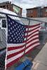 Flag on a Fence (AntyDiluvian) Tags: boston massachusetts eastboston mavericksquare flag fence lot mural