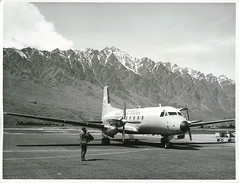 HS 748 at Queenstown with Remarkables in background (Archives New Zealand) Tags: archivesnewzealand archives archivesnz nationalpublicitystudios aotearoa tourism newzealand newzealandhistory nz nzhistory history