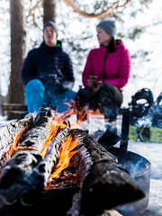 By a campfire in Lumbrejack's lodge 2 (VisitLakeland) Tags: campfire fire fireplace man woman relax lifestyle outdoor nature winter snow tuli nuotio retkeily ulkoilu finland kuopio