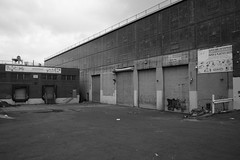 Super Win Enterprises Corp. Warehouse Building (Zach K) Tags: warehouse building factory storage paper products black white acros flushing avenue superwin super win enterprises bay lot loading angles industriral fujifilm fuji x100f wclx100 brooklyn ny nyc east williamsurg industrial zone