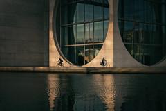 ⮐ U ⮑ (fehlfarben_bine) Tags: nikond800 nikon2401200mmf40 architecture paullöbehaus berlin geometry streetphotography spree river water contrast reflections spottymorninglight biker oppositedirections