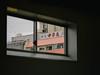 View   大阪市   PA130133 (mkreibohm) Tags: japan 日本 window view house signs japanese language symbols peek frame framing urban city osaka street architecture 大阪市 trainstation