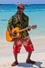 Negril Gitar Man (SjPhotoworld) Tags: caribbean caribbeansea jamaica negril firemans firemanslobster canon challenge travel holiday beach kitchen lobster happy beautiful sea sun ef 24105mm f4l is usm explore flickr flickrelite portrait people gitar gitarman gipsy music reggea