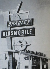 BRADLEY OLDSMOBILE - Tulsa, Ok - Sign by Craig Neon, circa 1956 (hmdavid) Tags: vintage sign car dealership bradley oldsmobile tulsa oklahoma 1950s midcentury modern roadside advertising craigneon signsofthetimes magazine neon globe arrow