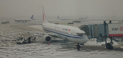 Airplane at the airport in a snow storm (phuong.sg@gmail.com) Tags: aircraft airfield airliner airplane airport antifreeze aviation badweather blizzard cockpit cold commercial condensation defrost deicing departure engine flight fly frost frozen ice jet journey machine plane preparation problem runway safety sky snow snowstorm storm takeoff taxiway terminal transport transportation travel waiting weather wing winter