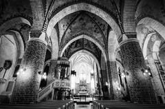 A Brick Cathedral (henriksundholm.com) Tags: church architecture cathedral interior nave bw blackandwhite monochrome shadows light columns brick confessional altar ceiling hdr strängnäs sweden sverige domkyrka