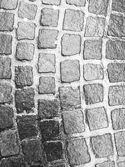On the cobbles. (Bennydorm) Tags: stonework stones stone arrangement form patterns shapes mono outdoor iphone5s march urban street road pavement cobblestones cobbles