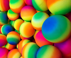 Spherical (Chancy Rendezvous) Tags: toy toys balls game arcade claw grab colorful colors blue red spheres shperical