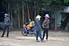 Passing time (Roving I) Tags: chatting conversations sunhats helmets waiting motorbikes loads facemasks bamboo villages vietnam