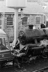 fill 'er up (a.pierre4840) Tags: olympus om2n zuiko 55mm f12 ilford ilfordhp5 hp5plus train steamtrain locomotive dorset swanage england bw blackandwhite monochrome noiretblanc railway station