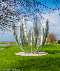 Choctaw monument (Jenny dot com) Tags: choctaw nativeamerican sculpture feathers green trees lake ireland midleton bailicpark