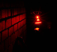 Photo Project :  Artificial Light (Dr Nigel) Tags: northeast england canon eos 300d cycle bicycle bike bikelights red taillight artificiallight brick wall building