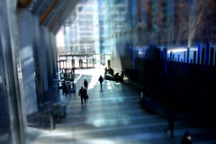 never truly alone (KevinIrvineChi) Tags: 150 n riverside chicago river architecture lobby light tiltshift aperture priority focus daylight indoors blue blues boingboing curbedchicago chicagoist person people walking silhouette glass steel new urban shiny floor doors gate art sony dscrx100
