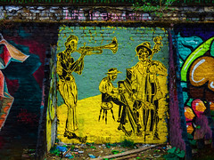 Skinny  Jazz (Steve Taylor (Photography)) Tags: stedhead art jazz band piano trumpet cello stool bricklane buttress graffiti mural streetart black yellow teal colourful contrast men uk gb england greatbritain unitedkingdom london plant