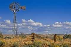 Windmill in High Desert 3924 D (jim.choate59) Tags: jchoate on1pics desert fence wascocounty oregon highdesert landscape windy lonely maupinoregon warmsprings clouds bluesky summer d610