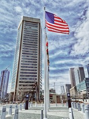 Baltimore World Trade Center, Inner Harbor, Baltimore MD 3-19-18 (Javcon117*) Tags: baltimore world trade center inner habor maryland md waterfront building skyscraper sky architecture flag clouds red white blue united states city cityscape stars stripes patriotic god bless america javcon117 frostphotos