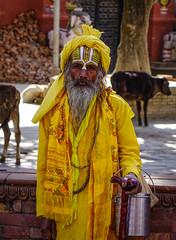 Sadhu in colourful clothes and painted face (phuong.sg@gmail.com) Tags: ascetic asia asian authentic baba benares color divine ethnic eyes faith ganges god guru hindu hinduism holy human indian kashi kathmandu katmandu male man mela men monk naga nepal nepalese orange paint perform pilgrimage portrait prayer religion religious sadhu shiva spiritual spirituality street templates temple varanasi wise yellow yogi