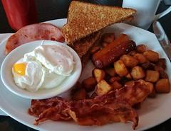 Two poached eggs, two slices bacon, two slices ham, two pork sausages, two slices toast (halved), home fries (Will S.) Tags: dunnsfamous dunnsfamousdeli dunns montrealsmokedmeat kosherdillpickle coleslaw latke sourcream applesauce mustard montrealsmokedmeatsandwich ryebread mypics nepean ottawa ontario canada upsidedown homefries