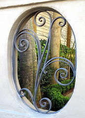 A glimpse of the garden, East Bay Street, Charleston, SC (Spencer Means) Tags: wall window opening ironwork iron garden house building architecture eastbay street ansonborough charleston sc southcarolina masonry wrought dwwg