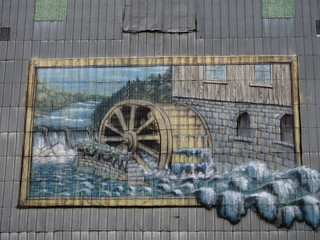 A history mural atop M & R Feeds, an old flour mill in Quyon, Quebec