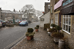 Snowing outside the Bakery (42jph) Tags: snow march spring uk england yorkshire wharfedale nikon d7200 snowing village grassington shop bakery