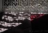 Very strong shadows cast by the bright Moroccan light (Nanooki ʕ•́ᴥ•̀ʔっ) Tags: morocco marrakech africa maisondelaphotographie photographymuseumofmarrakesh shadows window cushions
