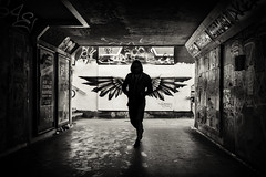 city of angels (Daz Smith) Tags: chosen dazsmith fujixt20 fuji xt20 andwhite bath city streetphotography people candid portrait citylife thecity urban streets uk monochrome blancoynegro blackandwhite mono wings angel graffiti mural silhouette hooded man bristol