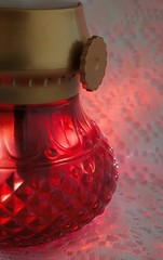 A ruby red glow (JLS Photography - Alaska) Tags: macromondays plastic oillamp jlsphotographyalaska glow red lace lamp macro