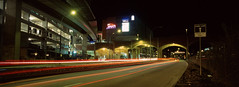 New West Cinema (Orion Alexis) Tags: film 35mm analog widescreen cinematic panorama xpan fujifilm tx1 fujichrome provia 100f 100 f vancouver city night photography long exposure light trails neon sign