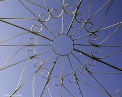 Through the Top Of the Gazebo (that_damn_duck) Tags: gazebo metal sky iron pattern pointofview