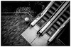 Ascendant (ianrwmccracken) Tags: escalator step pedestrian parallelogram city canon stair slide waverly edinburgh 35mm analogue tile chrome monochrome steel ianmccracken centre fujichrome movement fd50mmf18 bw shopping t90 metal water angle