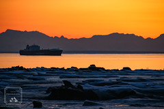 Heading into Port (fentonphotography) Tags: alaska sunset ship boat shore ice water orangesky winter cookinlet silhouette mountains horizon twilight dusk
