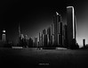 Afterlight (Katherine Young) Tags: bnw monochrome mono monochromatic dubai uae unitedarabemirates blackandwhite city urban cityscape skyline pano panorama burjkhalifa buildings towers offices skyscrapers construction sand structure modern contemporary