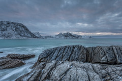 Erosion (Mika Laitinen) Tags: canon5dmarkiv europe hauklandbeach lofoten norway norwegiansea scandinavia beach cliff cloud cold landscape mountain nature outdoors rock shore sky snow sunset water wave winter nordland no