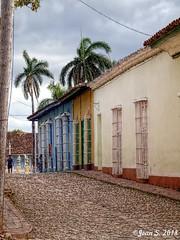 ... (Jean S..) Tags: street houses stone sky palmtree clouds windows outdoors trinidad cuba yellow blue