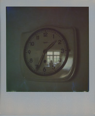 The Woman in the Kitchen Clock (sycamoretrees) Tags: 600 analog clock color600 color600201606 film girl impossible instantfilm integralfilm marianrainerharbach polaroid polaroidoriginals reflection silverframe silverframeedition slr680 window woman