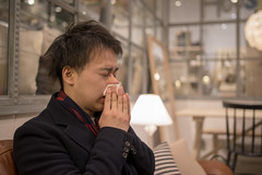 Young man blowing nose in living room (Apricot Cafe) Tags: img82718 adultsonly asia asianandindianethnicities fashionable handsomepeople japan japaneseethnicity smartcasual tamronsp35mmf18divcusdmodelf012 tokyojapan allergy blowingnose business businesscasual businessman candid city citylife coldandflu colorimage confidence day facialtissue indoors lifestyles livingroom men nose obscuredface oneperson onlyjapanese people photography scarf sideview sitting sneezing sofa success waistup youngadult yokohamashi kanagawaken jp
