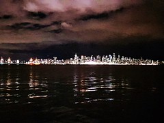 Angry sky, city lights and reflective sea (walneylad) Tags: vancouver britishcolumbia canada downtown city urban cityscape skyline harbour burrardinlet pacificocean clouds sky night evening dark lights reflections water sea ocean march spring buildings highrises towers
