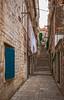 Narrow Street, Uphill, with Laundry (fotofrysk) Tags: narrowstreet laundry stones stairs pavers uphill buildings architecture istriamontenegroroadtrip croatia dubrovnik adriatic coastdalmatian coastsigma ex 1020mm f456 dc hnikon d7100 201710089525