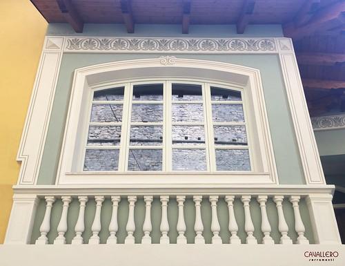 Finestra in legno a 4 ante ad arco con inglesina